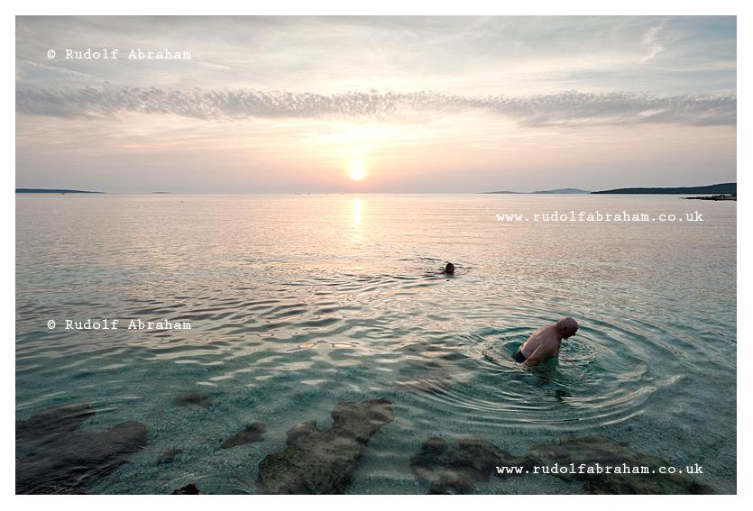 Sunset swimmers, on the island of Silba, Croatia, travel photography © Rudolf Abraham